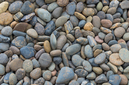 Multi color Pebble background in the swimming pool photo