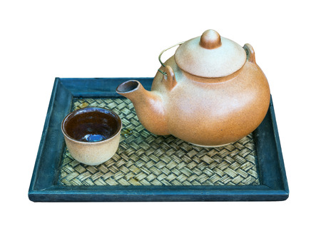 clay teapot on white background photo
