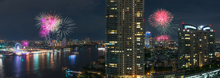 Fireworks night scene with bangkok cityscape river view photo