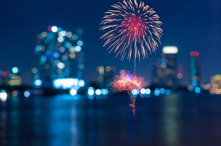 firework: Multicolor fireworks with bangkok cityscape Blurred Photo bokeh Stock Photo