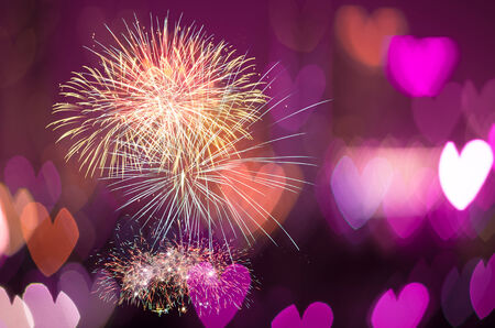 fires artificial: Multicolor fireworks on Heart bokeh background, Love concept Stock Photo