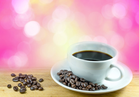 blurr: Coffee cup and beans on bokeh background Stock Photo