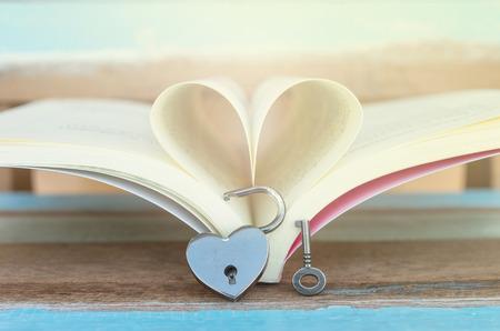Heart shaped padlock with key and Heart book photo