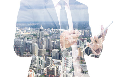 successful leadership: Double exposure of businessman with cityscape