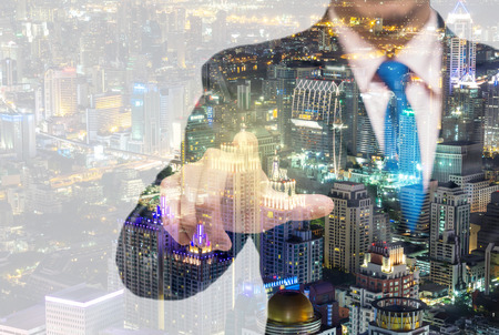 Double exposure of businessman with cityscape