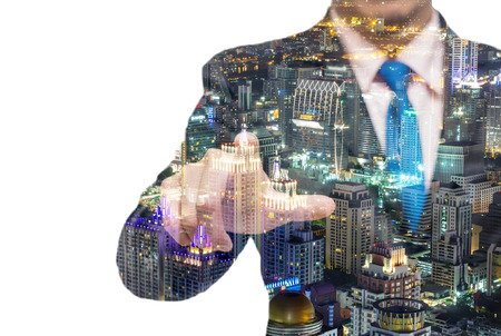 executive job search: Double exposure of businessman with cityscape