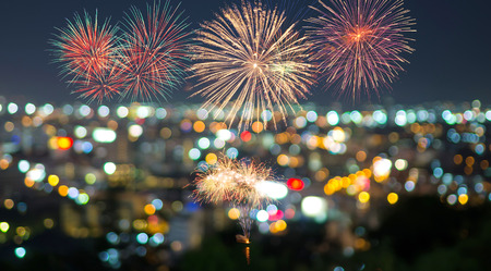 fires artificial: Multicolor fireworks with bangkok cityscape Blurred Photo bokeh Stock Photo