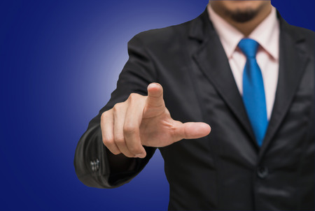navy blue suit: Businessman pointing or touching on dark blue background