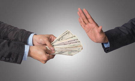payola: Businessman refusing the money offered by businessman on white background, no corruption