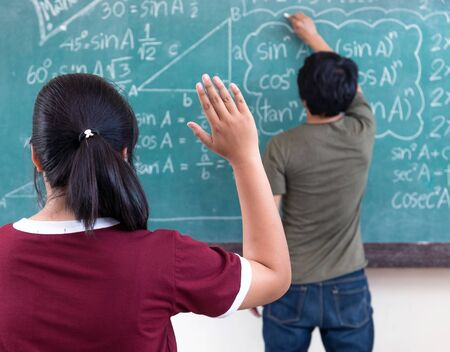 raised hands: Raised hands in classroom at School Stock Photo