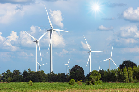 Wind turbine power generator on blue sky Stock Photo