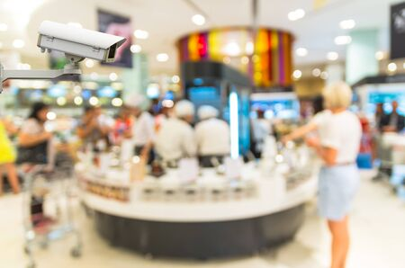 business security: Security camera monitoring the store blur with bokeh background