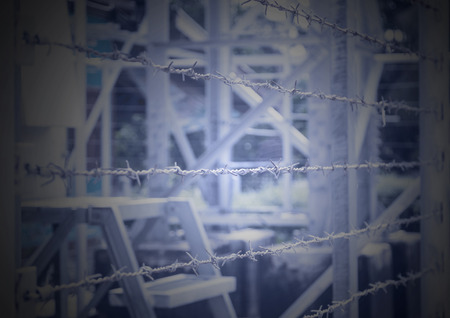 keep gate closed: Barbed Wire Fence border the dangerous area Stock Photo