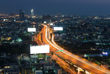 information highway: Big blank billboard with expressway and cityscape at twilight time
