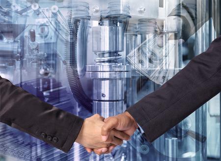 business handshake: Hand shake between a businessman on Industrial equipment background Stock Photo