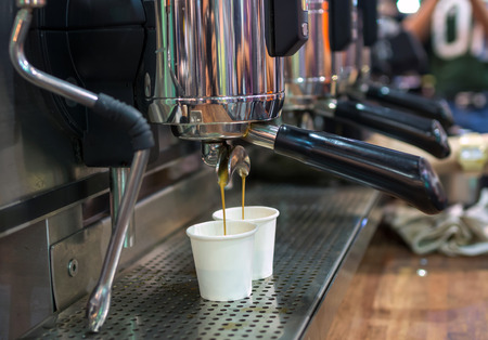 coffee machines: Coffee machine making espresso shot in a cafe shop
