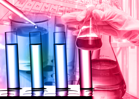 medical lighting: Chemical Laboratory,scientist dropping the reagent to test tube