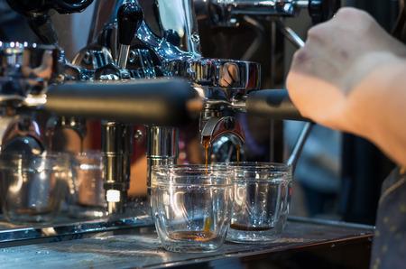 Coffee machine making espresso shot in a cafe shop