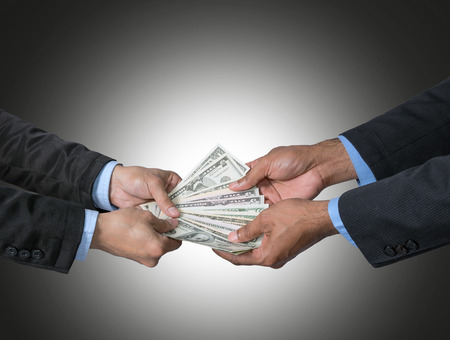 recieving: Businessman recieving the money offered by businessman on dark blue background,include clipping path