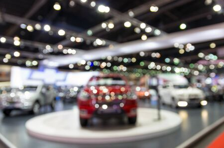 show room: Abstract blurred photo of motor show, car show room
