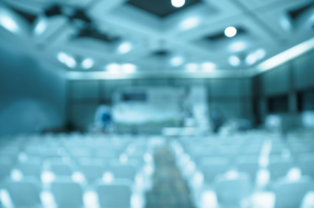 education event: Abstract blurred photo of Meeting preparation at bright conference hall. blue color tone