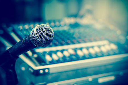 concert stage: Close up of microphone on mixer blurred background Stock Photo