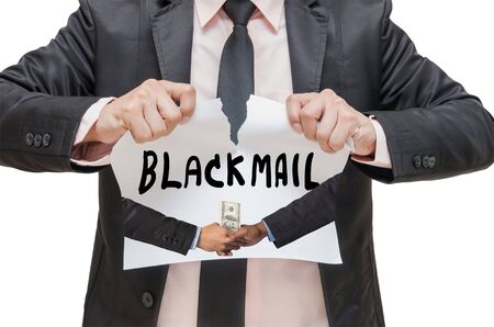 blackmail: Businessman ripping up the BLACKMAIL sign with receiving the money offered between two businessman on white background