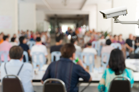 CCTV security camera on monitor the Meeting Blurred background at bright conference hall photo