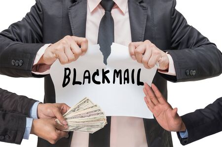 blackmail: Businessman ripping up the BLACKMAIL sign with refusing the money offered between two businessman on white background Stock Photo