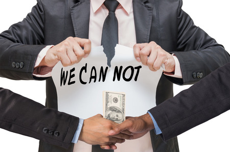 shake up: Businessman ripping up the WE CAN NOT sign with Hand shake between a businessman and dollar money on white background Stock Photo