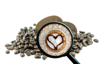 magnifying glass with background of roasted coffee beans to be coffee cup with heart shape, food and drink with business concept photo