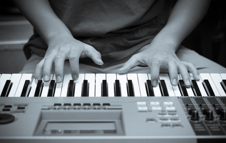ivories: hands playing the keyboard or piano Stock Photo