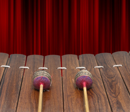 Closeup Thai musical instrument (Alto xylophone) on Realistic Red Curtain background, asian instrument,include clipping path
