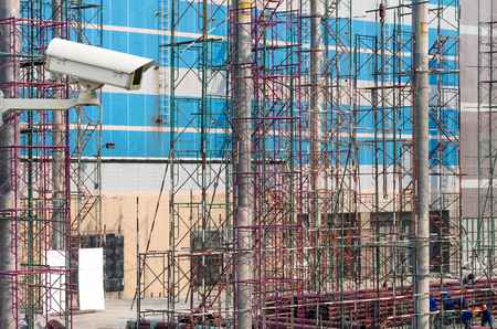 building site: CCTV security camera on monitor the construction site workers