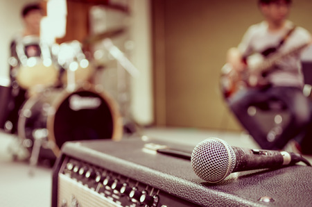 Closeup of microphone on musician blurred background Banco de Imagens