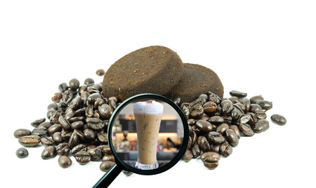magnifying glass with background of roasted coffee beans to be ice coffee cup on store blurred background, food and drink with business concept photo