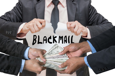 blackmail: Businessman ripping up the BLACKMAIL sign with Hand shake between a businessman and dollar money on white background
