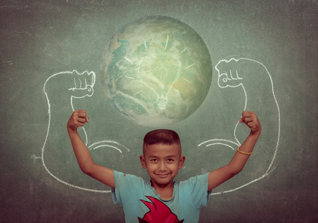 creative power: Asian strong children against blackboard in classroom, Education concept. Stock Photo