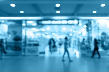 Abstract blurred photo of store with people in department store bokeh background photo