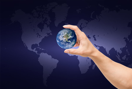 man hand catching the earth on world map photo