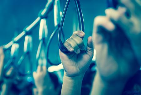 a loop: Hand handle loop in the sky train Stock Photo
