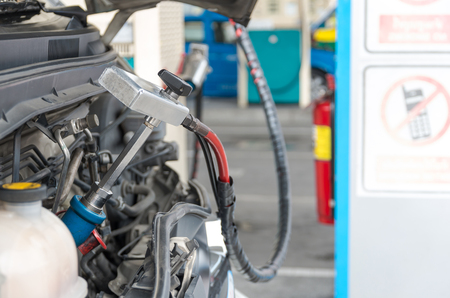 gas nozzle: Gas nozzle to add gas in car at gas station Stock Photo