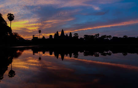 reap: Silhouette of Angkor Wat sunrise at Siem Reap. Cambodia Stock Photo