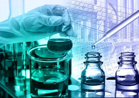 lighting technician: Chemical Laboratory,scientist dropping the reagent to test tube
