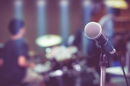 the musician: Close up of microphone on musician blurred background