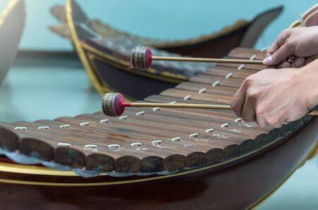 thai musical instrument: Hand hitting the Thai musical instrument (xylophone),asian instrument, focus on hand