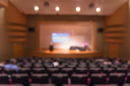 attendee: Abstract blurred photo of conference hall or meeting room with attendee background