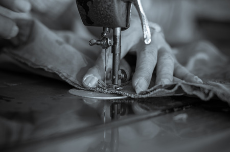 Closeup Sewing Process with old man designer hand, black and white tone