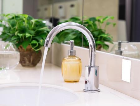 washbasin: Chrome faucet with washbasin in modern bathroom