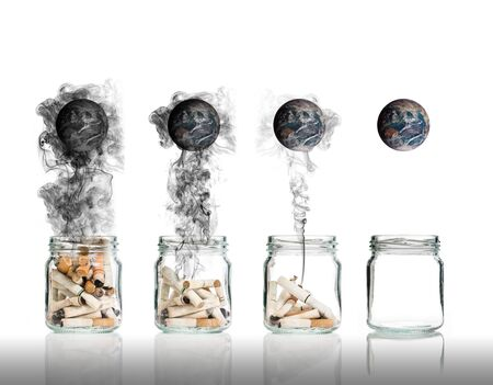 tobacco: Cigarette butt in bottle with smoke burning the world, world no tobacco day Stock Photo